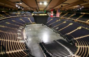 The seats and a screen inside of Madison Square Garden
