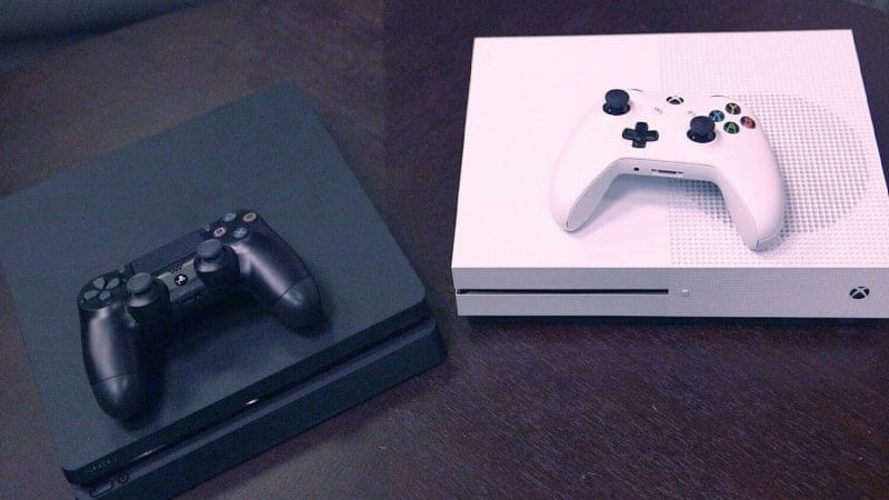 Two consoles - black and white