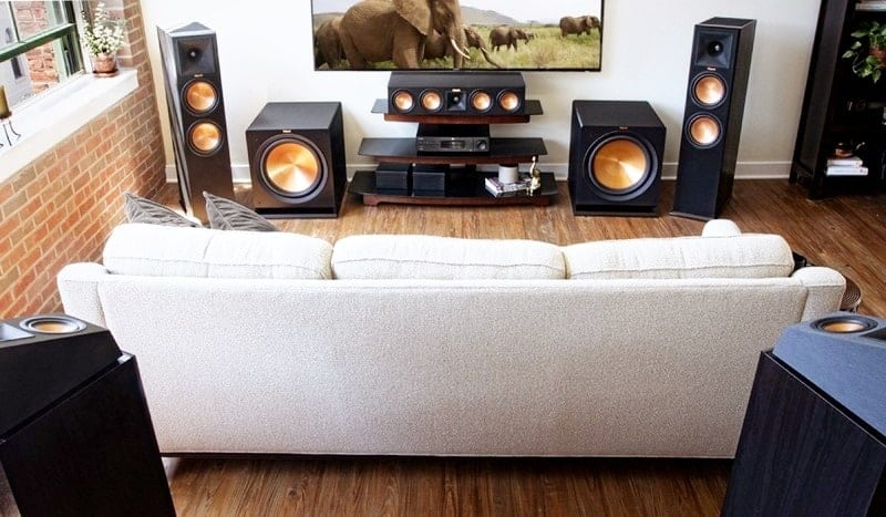 Sound system and a white sofa are in the living room