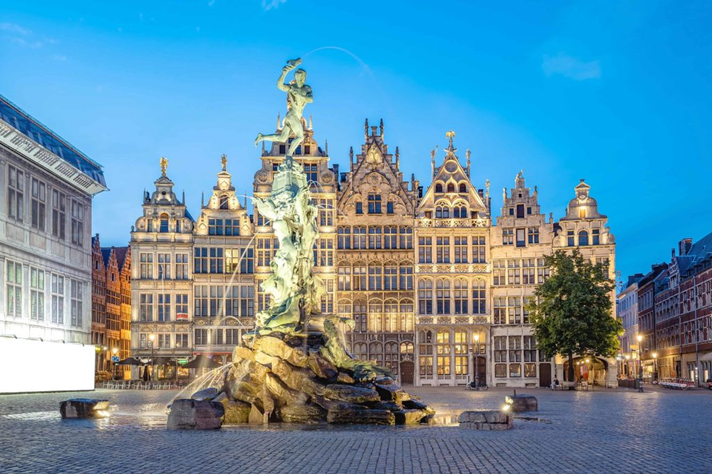 Historical buildings and a statue in Antwerp