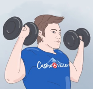 A young guy in CasinoValley t-shirt is lifting dumbbells