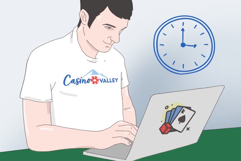 A man in CasinoValley t-shirt is gambling on the computer