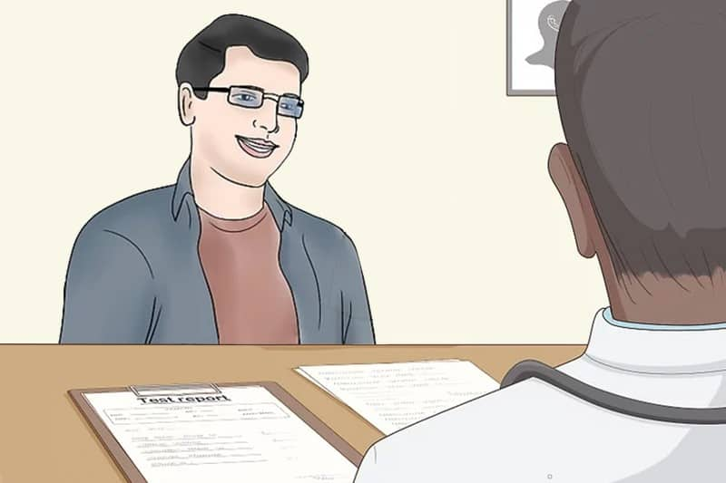 A young man wearing glasses is at the doctor's appointment