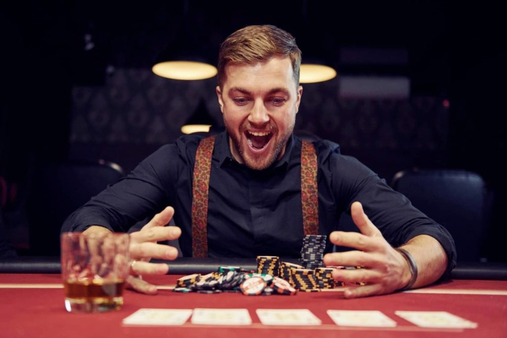 A young gambler is feeling exited after winning in casino