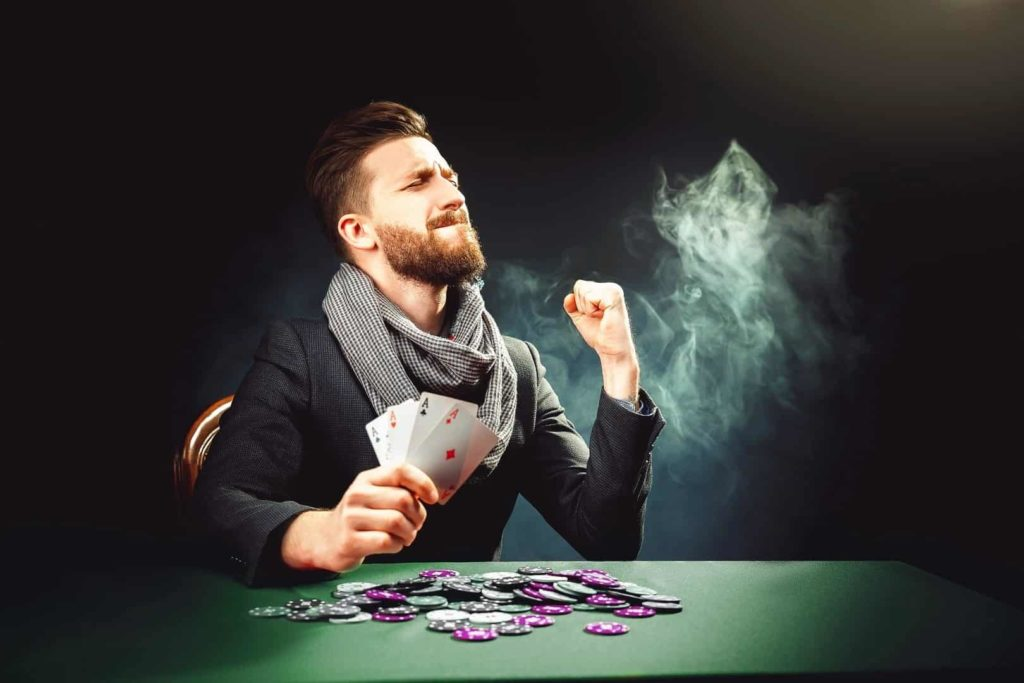 Pocker player emotionally reacts on his win in casino