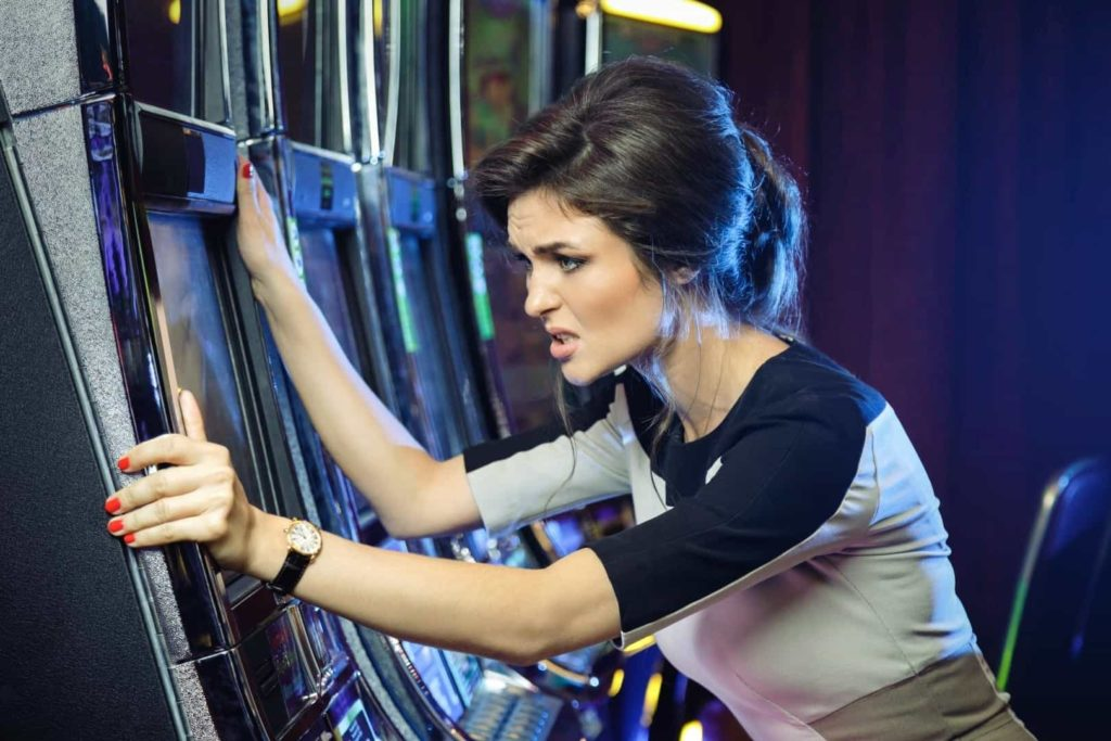 Young woman lost his money after playing slot games in casino