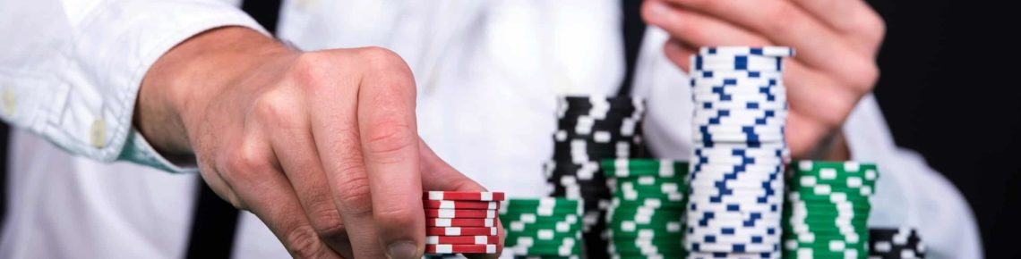 A poker player puts chips at the table