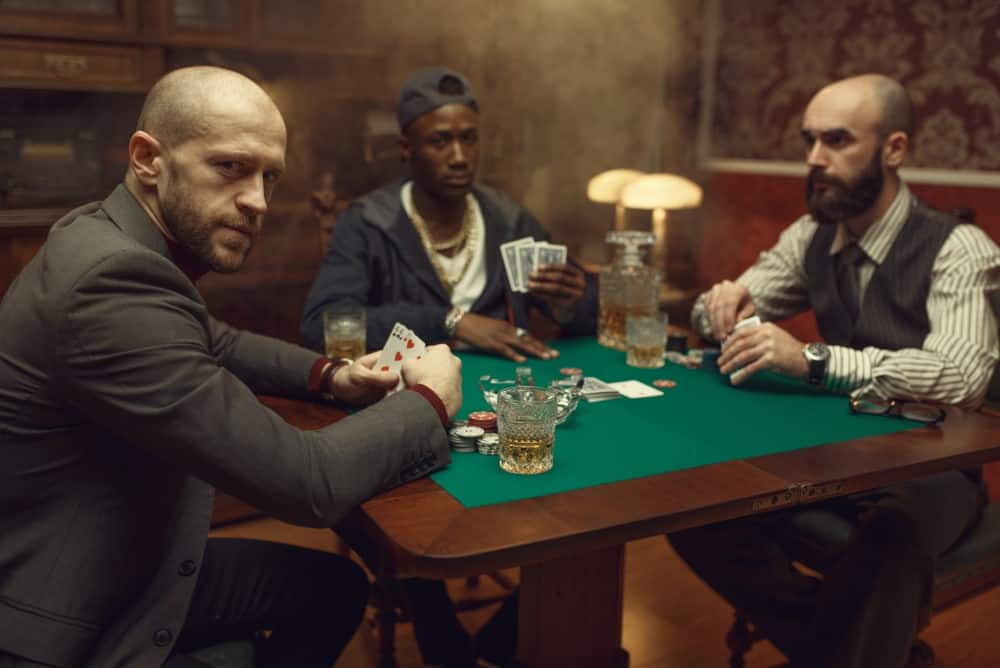 Poker players sitting at the table with crossed legs