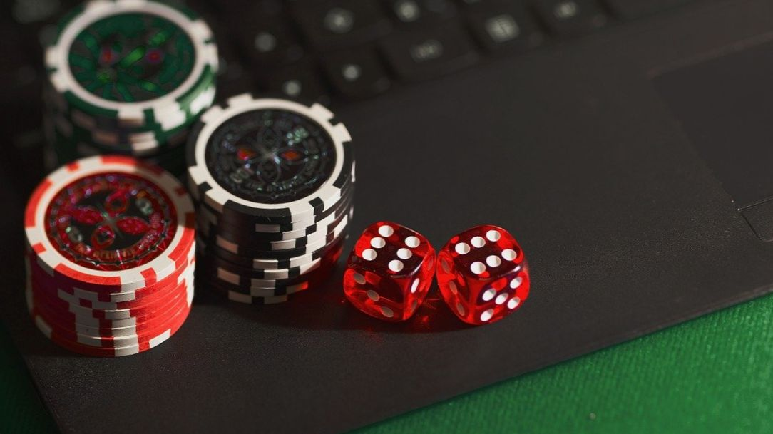 Casino tokens on a laptop