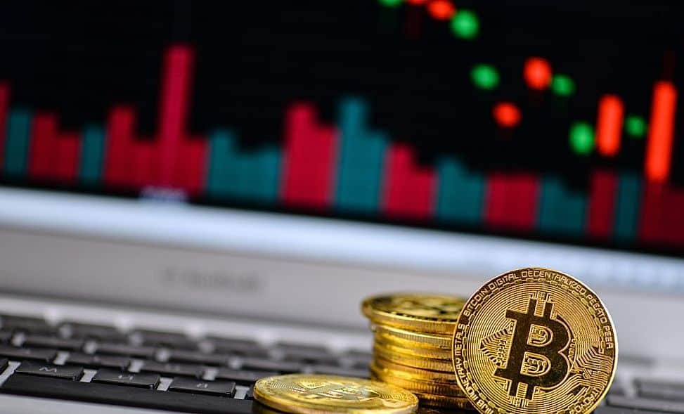 Bitcoin laying on laptop