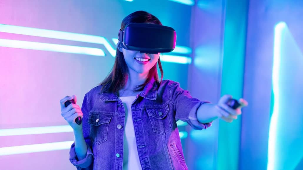 Happy Girl Wearing Virtual Reality Goggles Playing Video